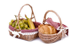Fresh basket. With banana, grapes and croissant Stock Images