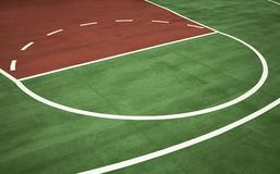 Fresh Basketball Court Background. White lines of basketball court stand out on background of fresh green Royalty Free Stock Photo