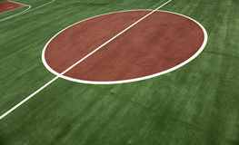 Fresh Basketball Court Background. White lines of basketball court stand out on background of fresh green Stock Photos