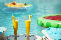 Free Fresh Bass Citrus Juices. Girl On An Air Mattress In The Background In The Pool Water. The Atmosphere Of A Holiday By The Pool. Royalty Free Stock Photos - 158430418