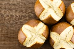Fresh bavarian bread bun on brown wood. Bavarian bread buns top view on brown wood background fresh baked loaves Stock Photo