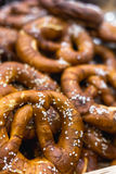 Fresh Bavarian Bretzels or pretzels, vertical image. With selective focus and blurred background for copy space. Bread and bakery products concept Royalty Free Stock Photo