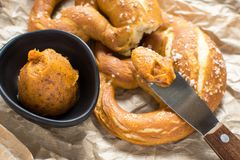 Bavarian Pretzel with Homemade Mangalica Fat Spread. Fresh Bavarian Pretzel with Homemade Orange Mangalica Fat Spread Royalty Free Stock Images