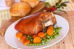 Fresh Bavarian roasted knuckle of pork with carrot Stock Photos