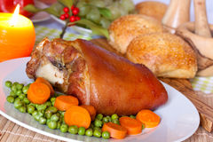 Fresh Bavarian roasted knuckle of pork with carrot Stock Photo