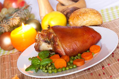 Fresh Bavarian roasted knuckle of pork with carrot Royalty Free Stock Image