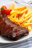 Fresh BBQ, marinated spareribs and fries Stock Image