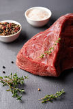Fresh beaf meat. Raw beaf meat and  spices over stoun table Stock Image