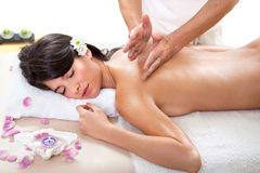Fresh and Beautiful brunette woman having massage Royalty Free Stock Image