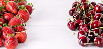 Fresh Beautiful Ripe Berries on a White Wooden Background Sweet Strawberries and Cherry Frame Long.  stock photos