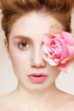 Fresh beauty. Close-up portrait of young beautiful fresh girl with pink rose Stock Photos