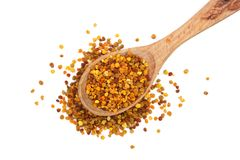 Fresh bee pollen in wooden spoon isolated on white background. Top view. Flat lay.  stock photography