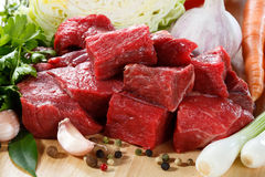 Fresh beef. Fresh raw meat and vegetables Royalty Free Stock Photo
