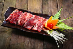 Fresh beef back ribs on wooden background. Uncooked Royalty Free Stock Photography