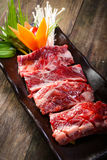 Fresh beef back ribs on wooden background Royalty Free Stock Photos