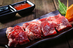 Fresh beef back ribs on wooden background. Uncooked Stock Photography