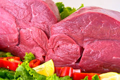 Fresh beef on board ready to cook isolated on whit. E background Royalty Free Stock Photos