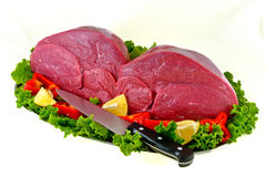 Fresh beef on board ready to cook isolated on whit. E background Royalty Free Stock Images