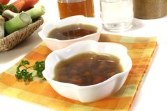 Fresh Beef Consomme. Beef Consomme in a bowl on light background Stock Photos