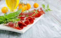 Fresh beef cuts, carpaccio, with vegetables and Royalty Free Stock Image