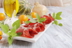 Fresh beef cuts, carpaccio, with vegetables and Stock Photo