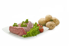 Fresh beef joint with vegetables Stock Image