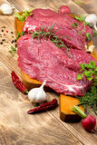 Fresh beef meat with spices - seasoning Royalty Free Stock Photos