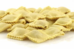 Fresh beef ravioli. Beautiful raw ravioli stuffed  with ground beef shallow DOF Stock Photo