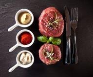 Fresh beef raw steaks on black stone Stock Photos