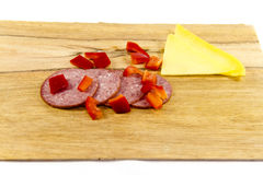 Fresh Beef Salami with Capsicum Cubes and Cheese. On edge Board Stock Photos