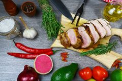 Fresh beef steak and aromatic herbs, spices and vegetables for cooking , on rustic background, top view, frame royalty free stock images