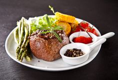 Fresh beef steak on black stone Royalty Free Stock Photo