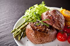 Fresh beef steak on black stone Royalty Free Stock Photography