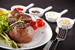 Fresh beef steak on black stone Royalty Free Stock Images