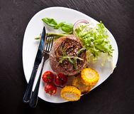 Fresh beef steak on black stone Stock Photo