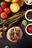 Fresh beef steak on black stone Stock Photography