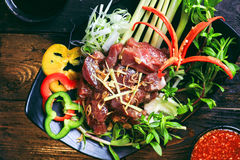 Fresh beef steak with herbs, lemongrass and chili sauce on table Royalty Free Stock Photo