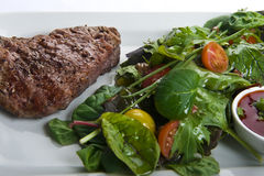 Fresh beef steak with salad Stock Image