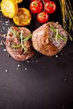Fresh beef steaks on black stone Stock Photo