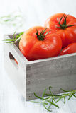 Fresh beef tomatoes in box Stock Photos