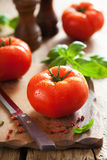 Fresh beef tomatoes on cutting board Royalty Free Stock Photo