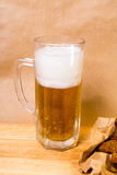 Fresh beer with bread toast. On wood Royalty Free Stock Photo