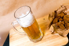 Fresh beer with bread toast. On wood Stock Photo