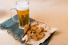 Fresh beer with bread toast. On wood Stock Photos