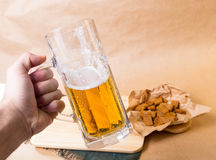Fresh beer with bread toast Stock Images