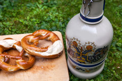 Fresh beer mug and pretzel Stock Images