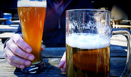 Fresh beer at open air bar Royalty Free Stock Images