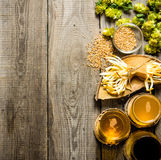 Fresh beer and the salty cheese on a wooden table. Stock Images