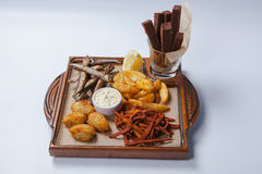 Fresh beer snacks assortment on wooden board stock image