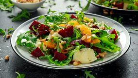 Free Fresh Beet, Orange Salad With Wild Rocket, Cheese And Pine Nuts. Healthy Summer Food Stock Photography - 116519432
